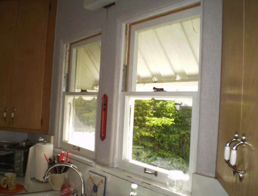 """The kitchen """"After"""" with original windows restored"""