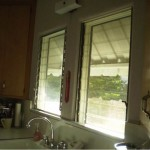 "Kitchen windows ""Before"" with drafty old louvers"